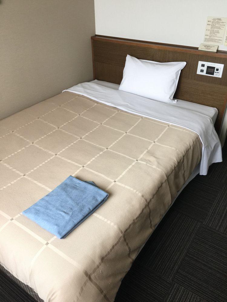 ホテルルートイン鶴岡駅前シングルルームのベッド