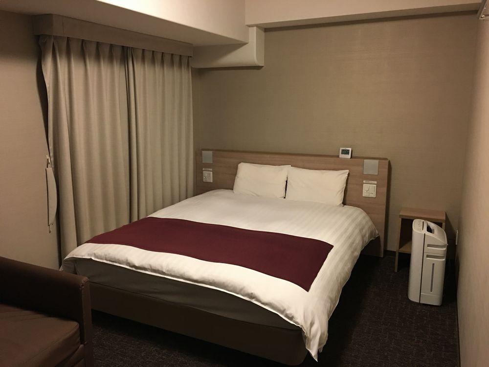 ドーミーインEXPRESS松江の禁煙デラックスクイーンルームのベッド