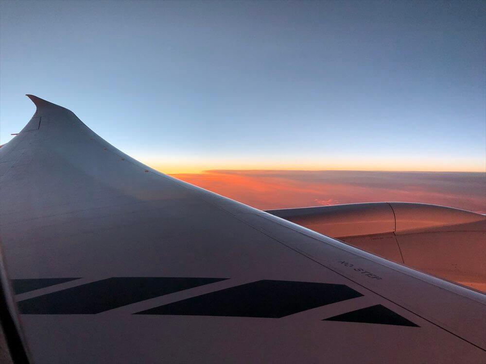 JAL422便ビジネスクラスから見た夕焼け