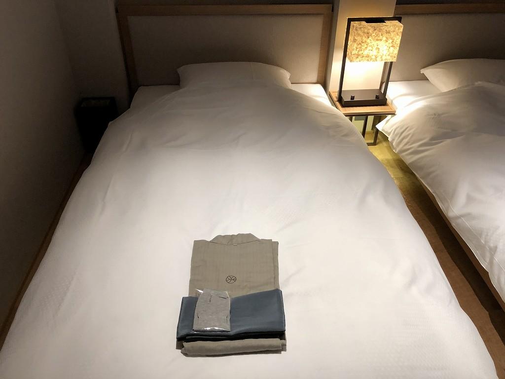 由縁別邸 代田のメゾネットルームのベッド